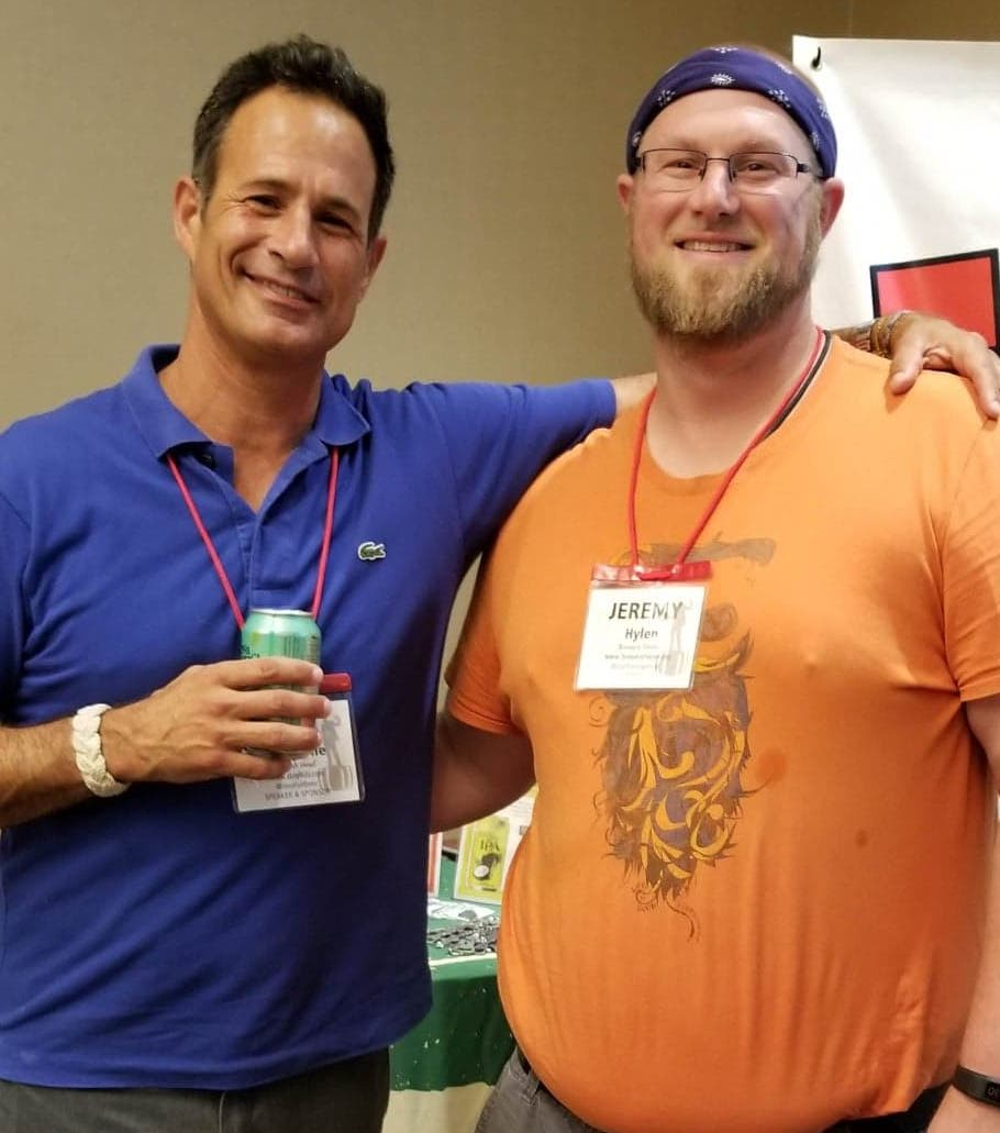Sam Calagione and Jeremy Hylen smile for a photo in London County, Virgina