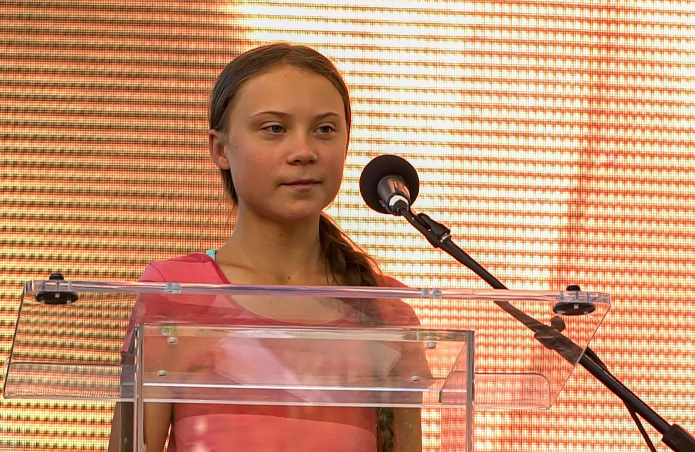 Greta Thunberg giving a speech