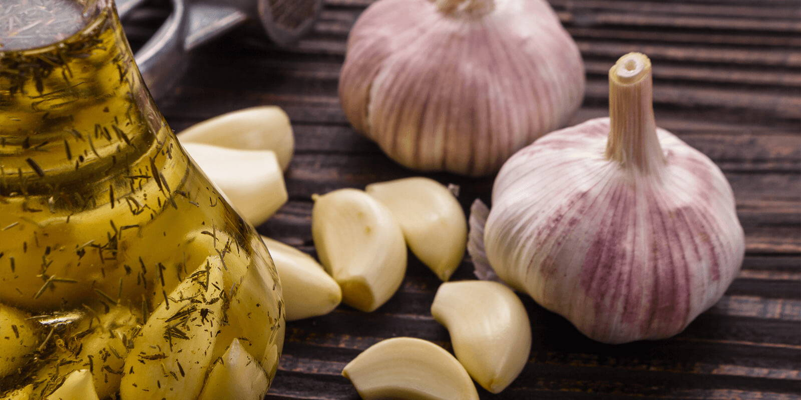 Garlic cloves and olive oil.
