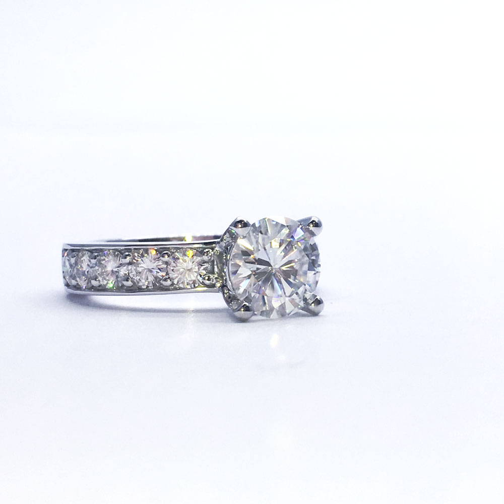 Custom white gold and diamond engagement ring