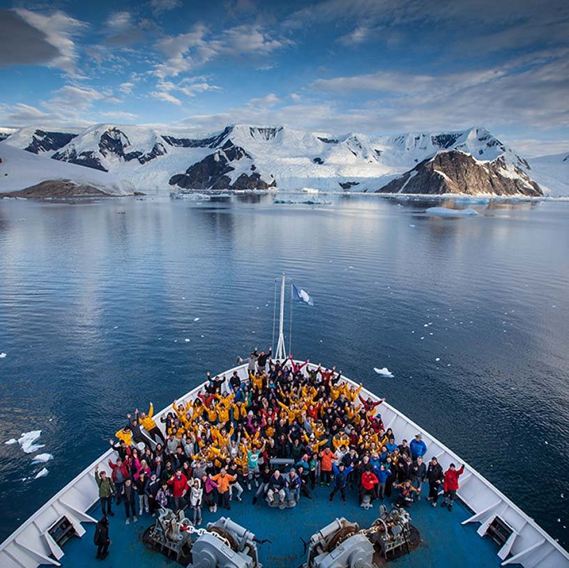 People on a boat on the arctic sea