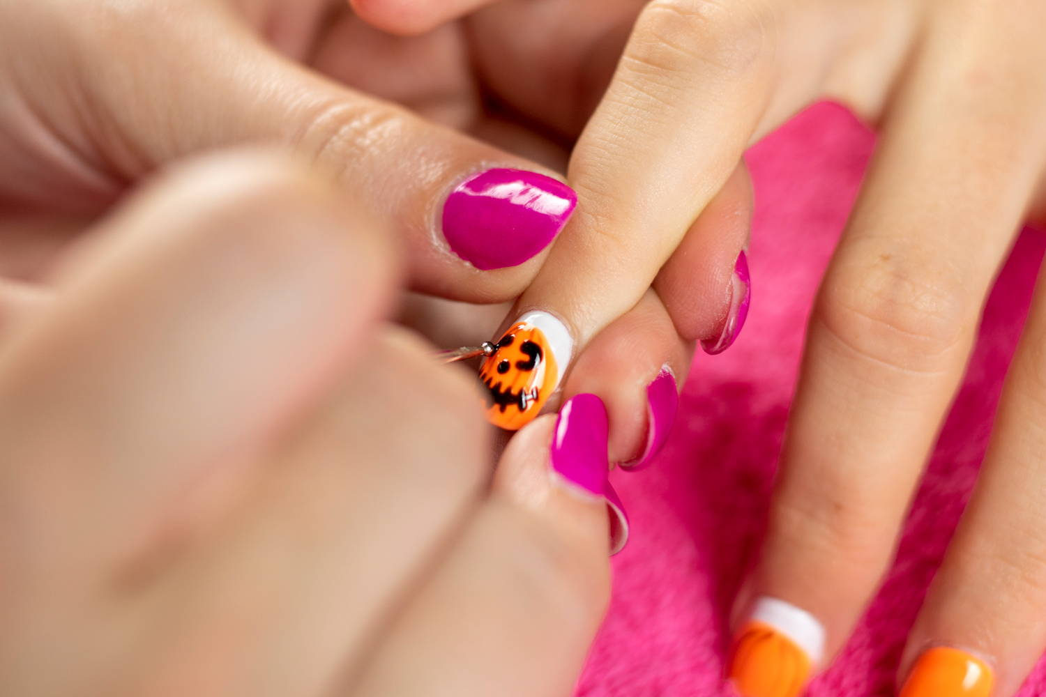 Pumpkin nails eye details added to nail using a dotting tool and ORLY Liquid Vinyl