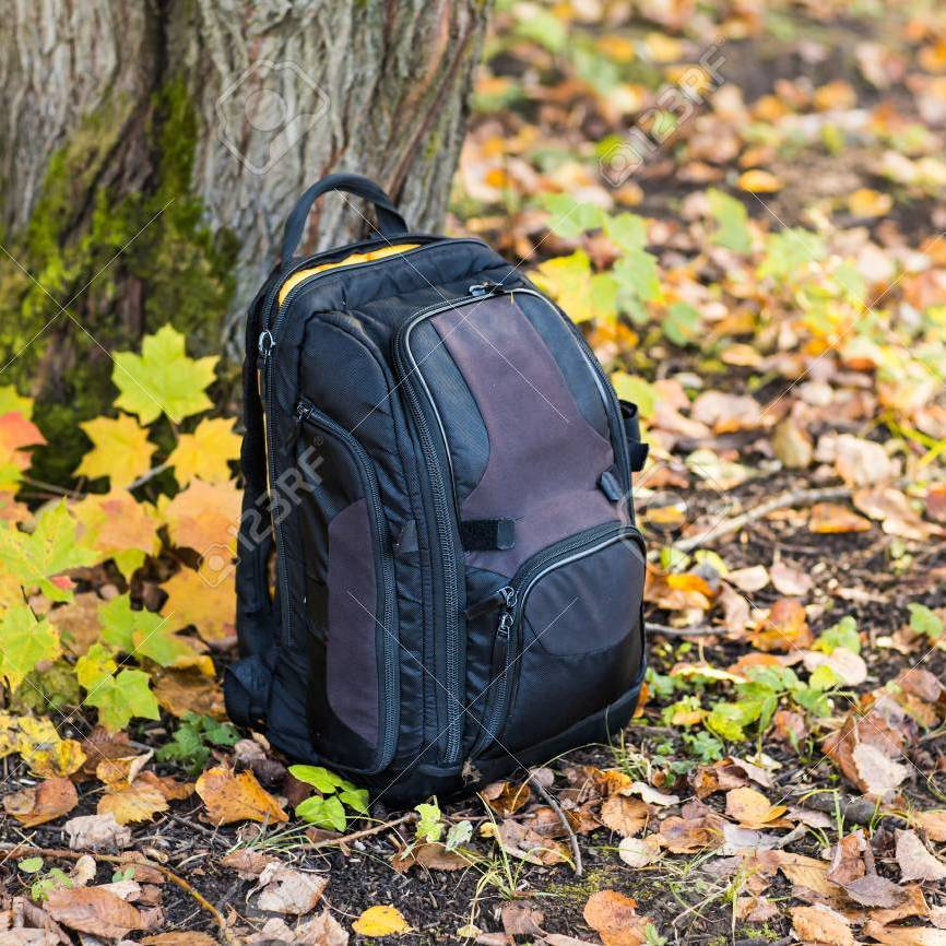 63729438 backpack in the woods concept travel tourism