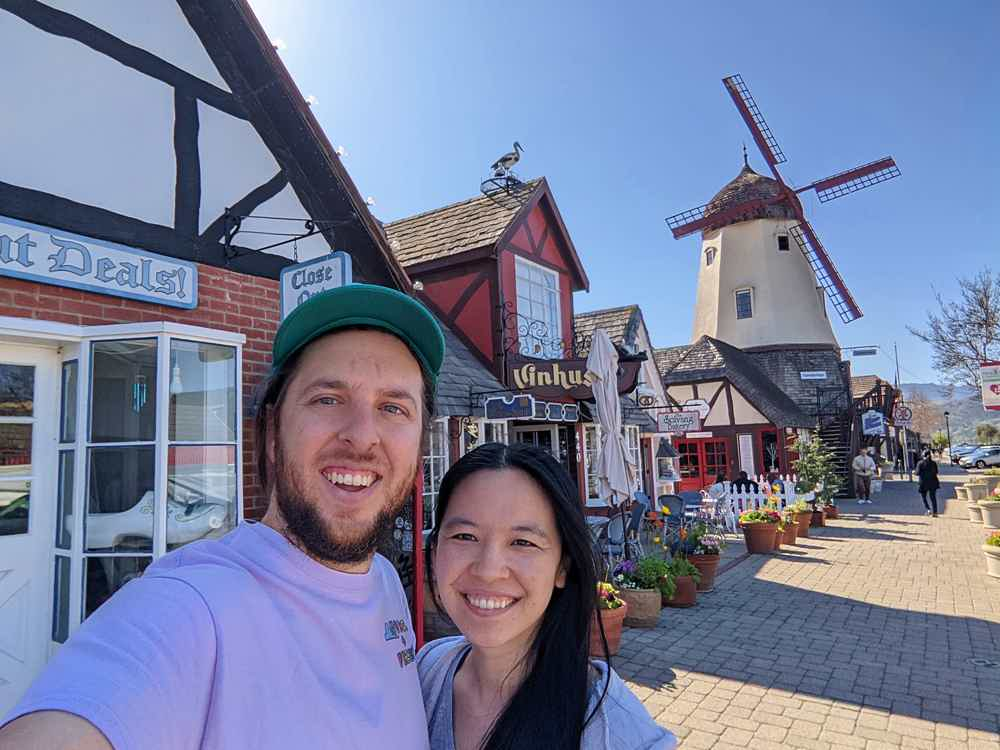 Man and Woman take a selfie together on a street in Solvang Santa Ynez Valley