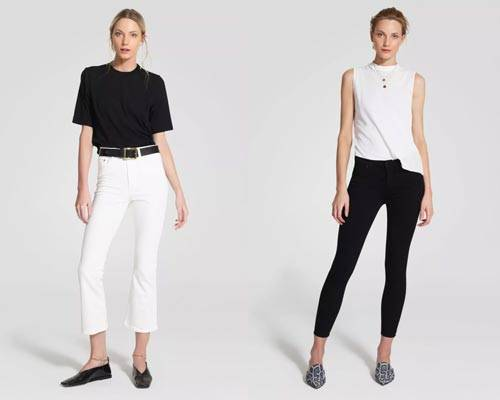 Woman wearing white skinny fit high waisted jeans with  black belt and black oversized tee tucked in and woman wearing black super skinny stretch jeans with white sleeveless top from sustainable denim brand Nobody Denim
