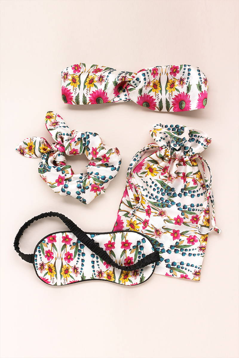 Perfect for sleepovers and trips away, The Wildflowers Ivory Silk Sleepover Kit includes a Silk Eyemask, Scrunchies and Headband which come in a matching silk pouch.
