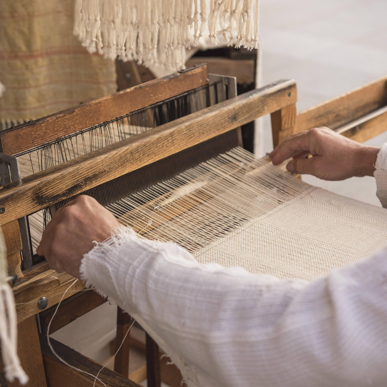Artisan hand-weaving sustainable home decor