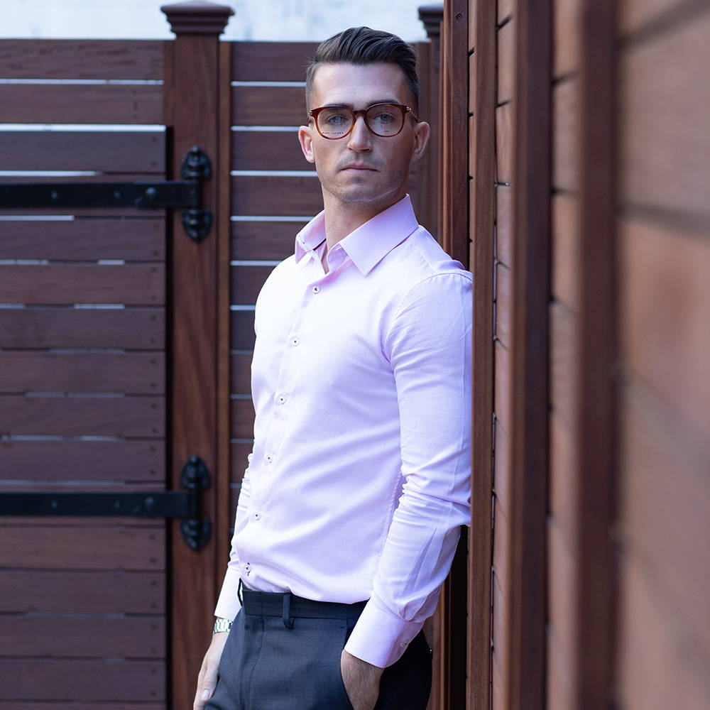 pink-slim-dress-shirt-model-with-glasses-standing