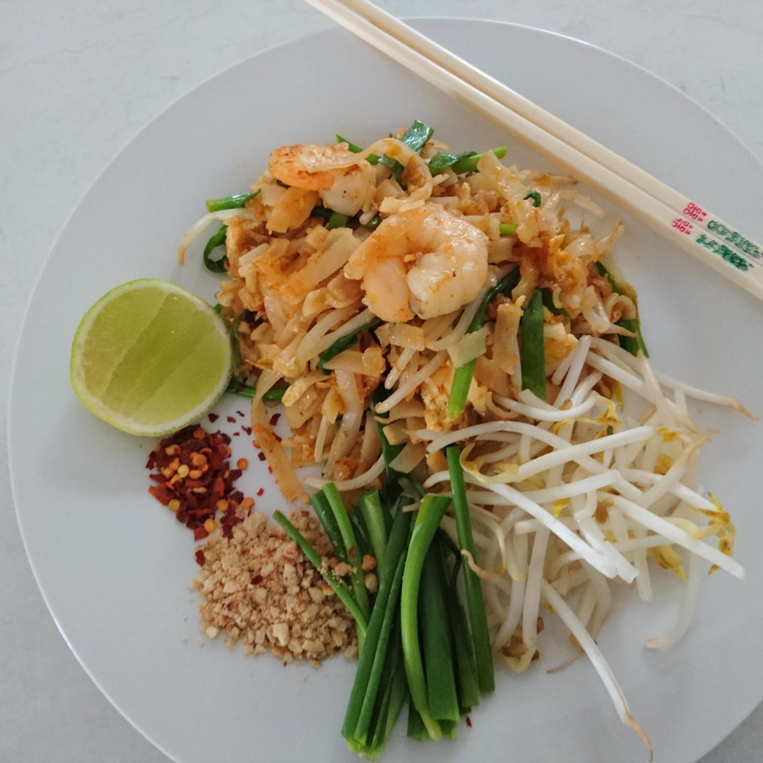 Date: 28 Oct 2019 (Mon) 33rd Main: Pad Thai (Remake 1) [Score: 8.3] Cuisine: Thai Dish Type: Main  This Pad Thai dish is a remake of the dish I made on the 27 Oct 2019 (Tue). Even though: 1.I have reduced the soaking time (in boiling water) by 2 minutes, the rice noodles were still soft. 2.I have also increased the Pad Thai sauce twice the amount I previously used. 3.In addition, I've also seasoned the prawns, added more beansprout and chives into the dish, and added chilli flakes into the garnish.  The score merely increased from 7.8 to 8.3. I'm suspecting two reasons: 1.Valcom Authentic Thai Pad Thai Paste is not the right Pad Thai paste for the liking, or 2.I didn't stir-fry the rice noodles under high heat long enough.  Any comments?