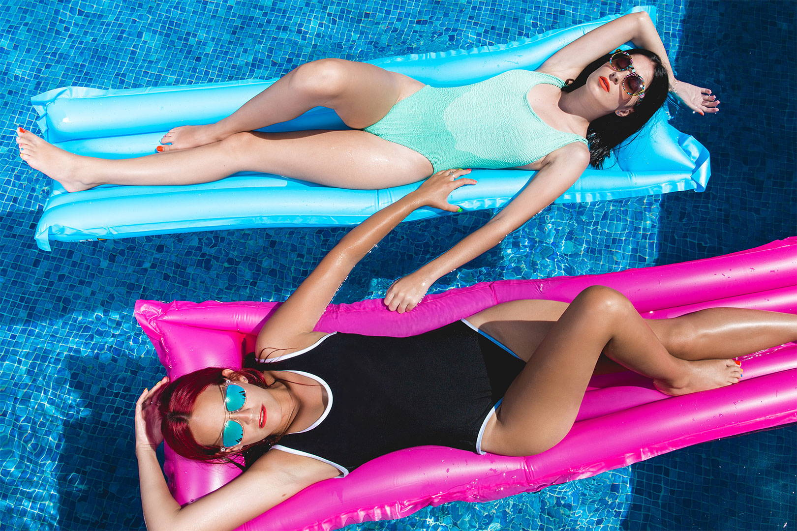 two girls in swimsuit in a pool floating