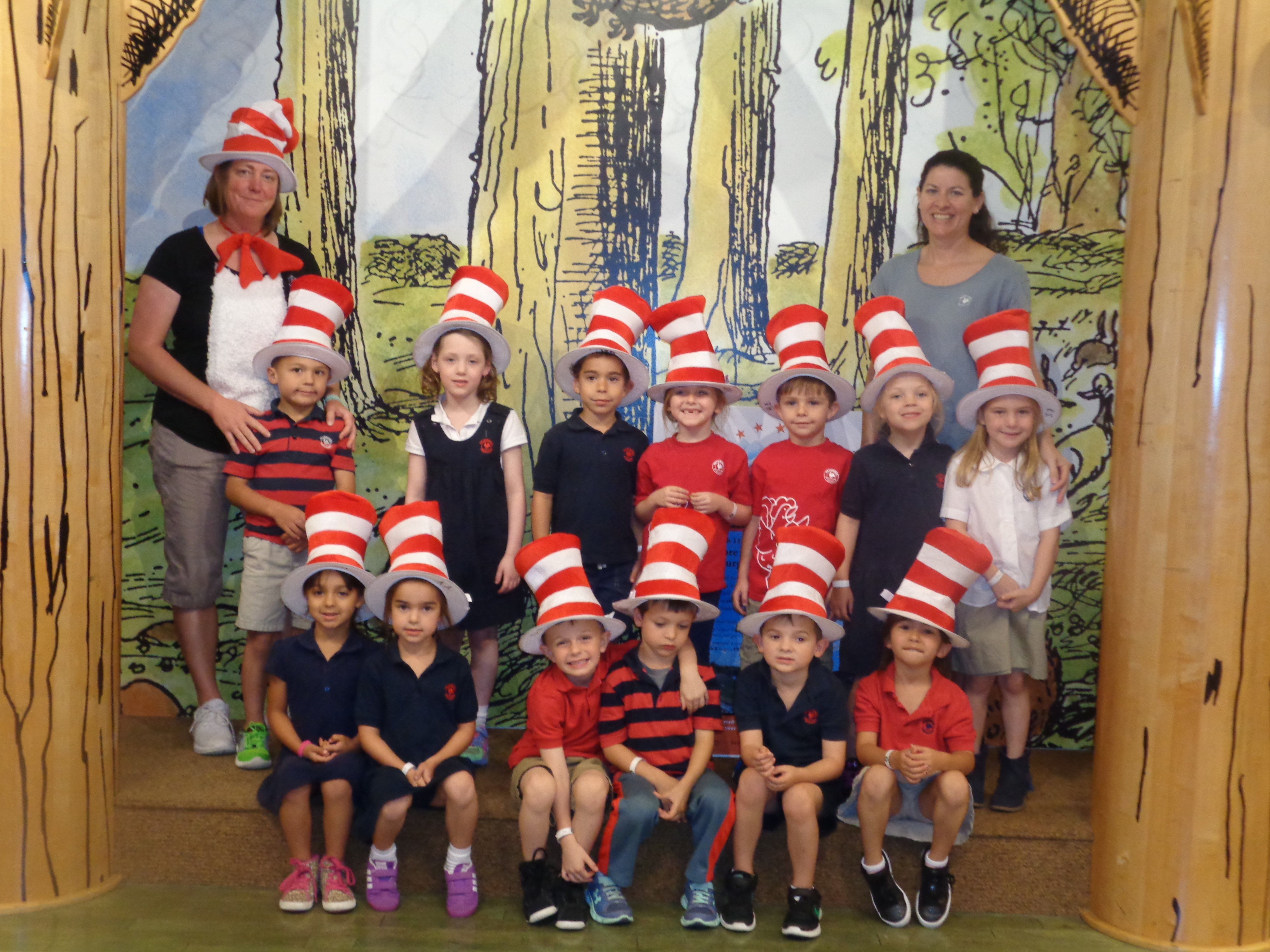 """Primrose private kindergarten class poses wearing """"Cat in the hat"""" inspired hats for Read across America day"""
