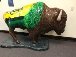 life size bison with green and yellow paint