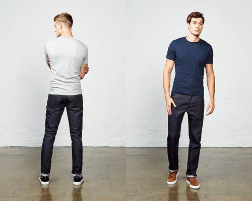Man wearing regular cut Hiut denim organic cotton jeans and back of man wearing slim fit Hiut denim indigo denim jeans
