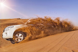 Sand-Bashing thrills with a racing SUV in the beautiful desert sunset