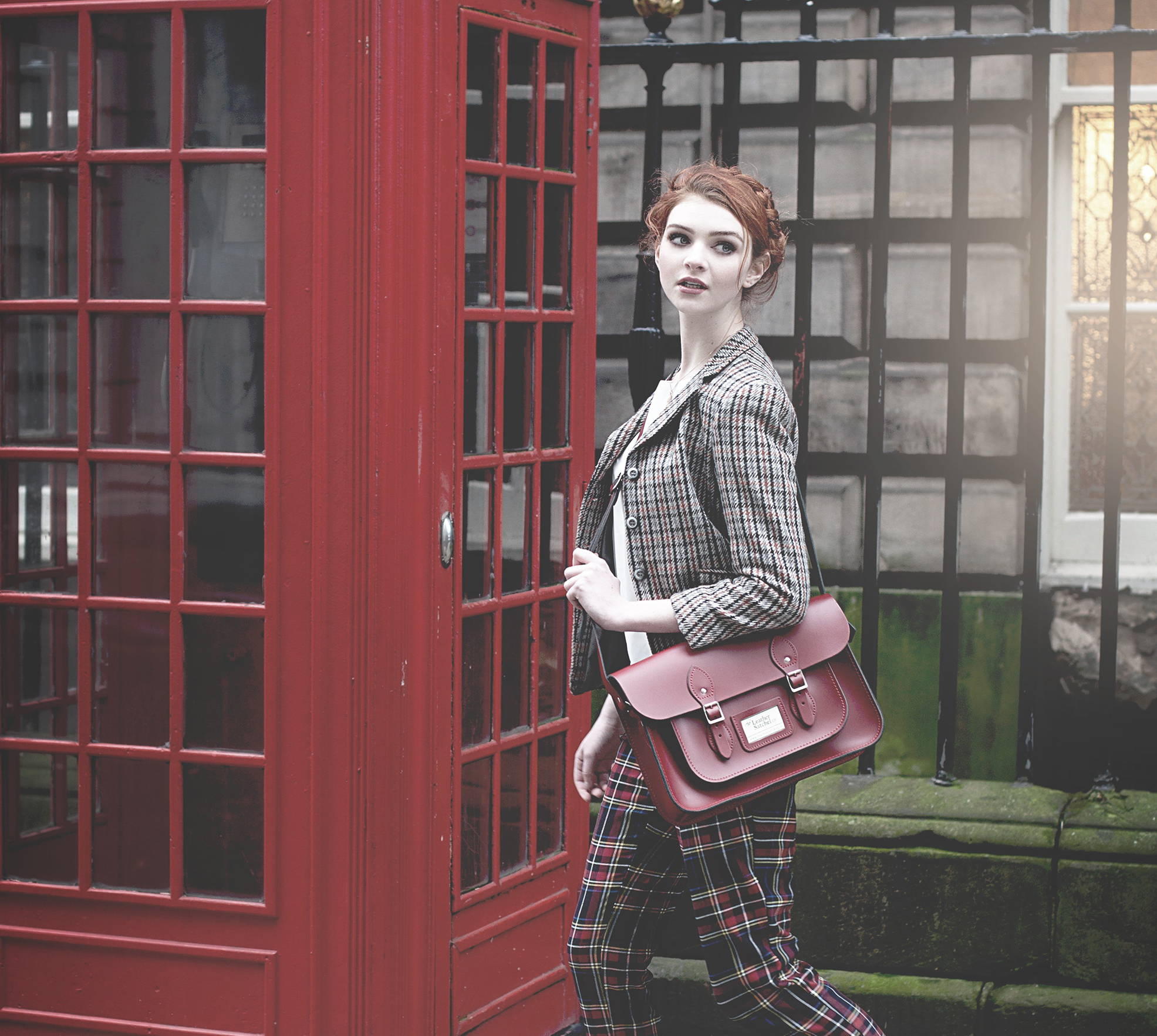 Woman Wearing a Red Leather Satchel