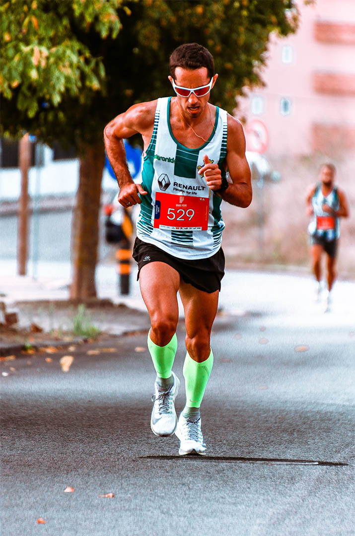 Man running with compression sleeves
