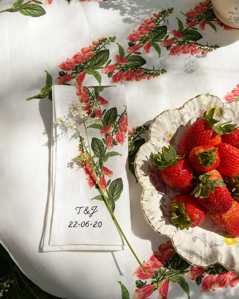 Bowl of strawberries on YOLKE monogrammed foxglove tablecloths