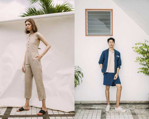 woman wearing hand woven cotton sustainable button up sleeveless jumpsuit with leather sandals and man wearing indigo deconstructed blazer with cream shirt and indigo shorts from Seeker x Retriever
