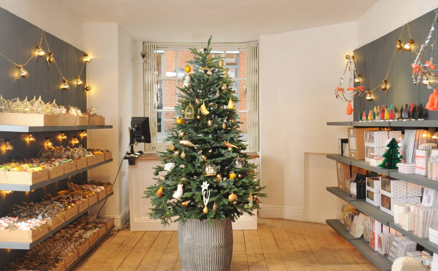a flurry of gold stars and candy cane stripes in the middle of it all our very first hambledon tree decked to the nines and truly resplendent - Candy Cane Christmas Shop
