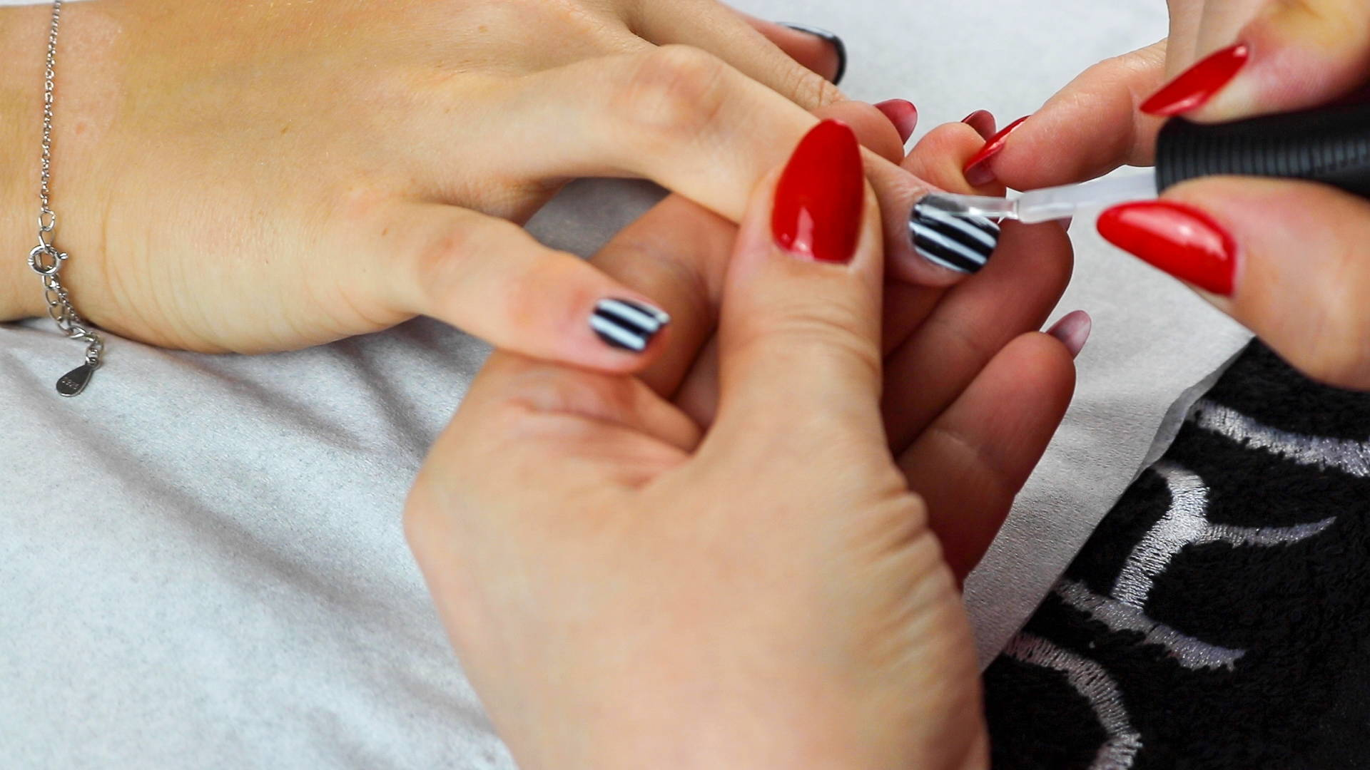 ORLY Glosser Topcoat being painted onto complete Jack Skellington nails