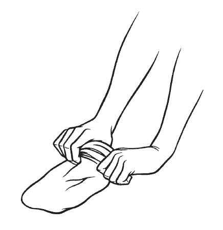 Hands putting rolled up stocking on foot