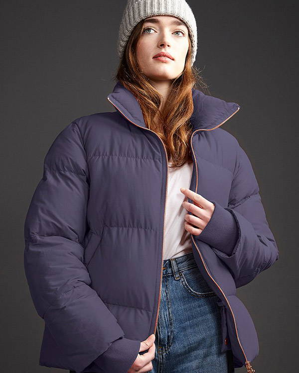Woman wearing purple recycled polyester insulated jacket with rose gold zip from LangerChen