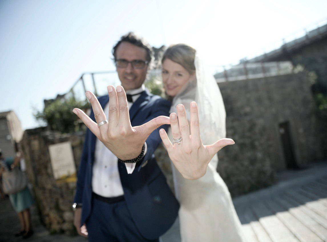 married couple showing off wedding rings yves lemay jewelry