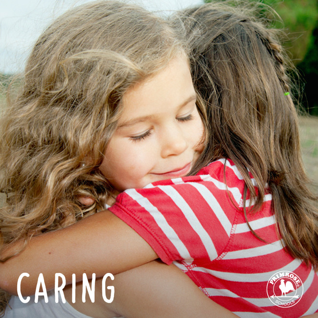 Young girl compassionately hugs her friend