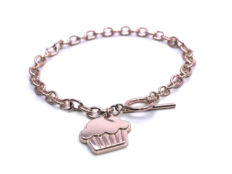 rose gold charm bracelet with a muffin-shaped charm in rose gold