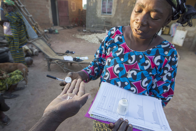 Diane, community drug distributor preparing a dose of Ivermectin