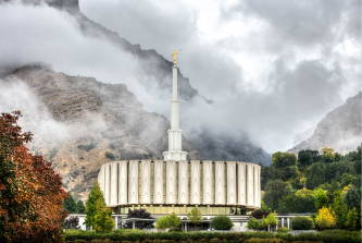The Provo Temple and mountains rising through the fog.