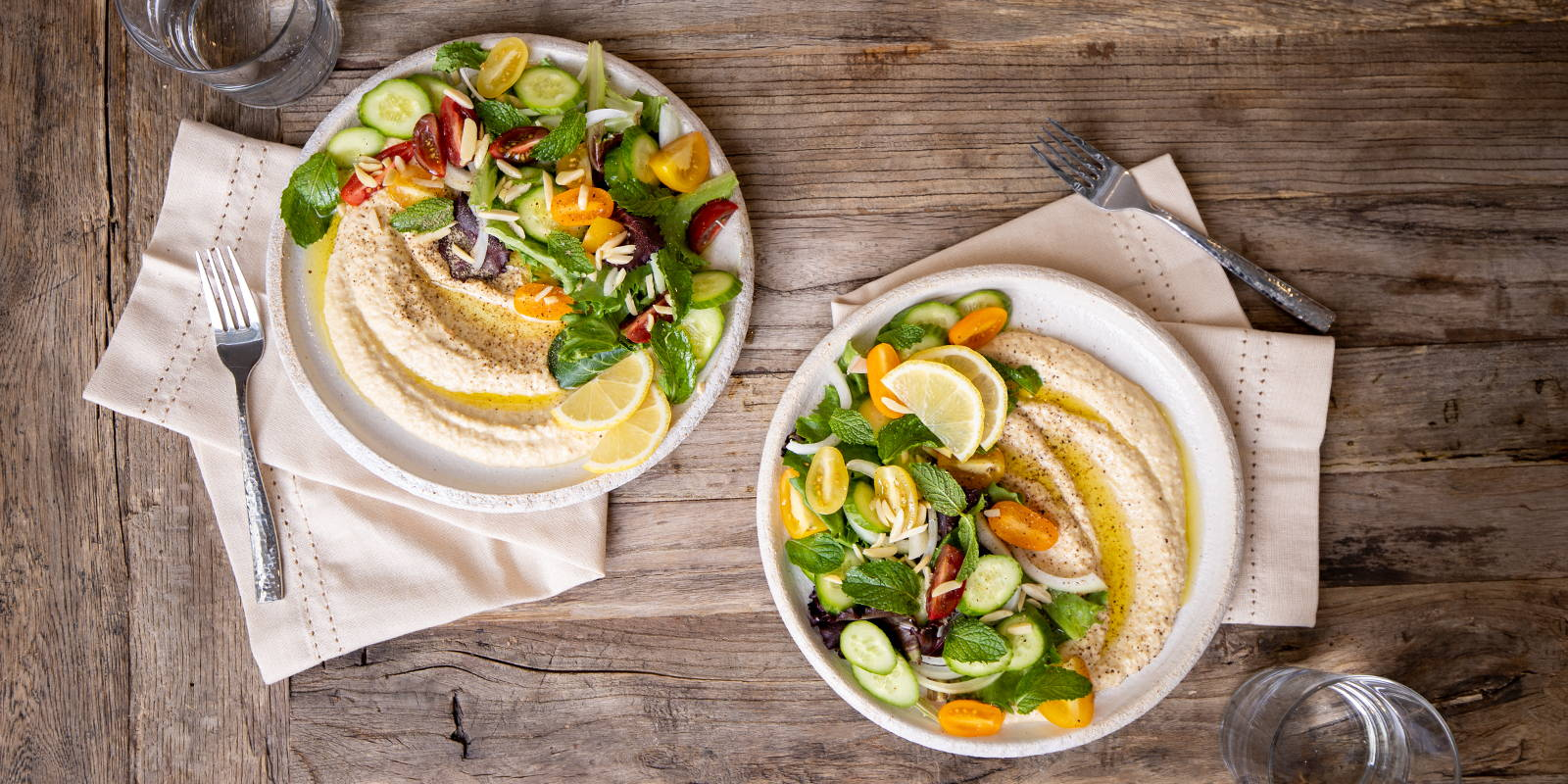 Serving hummus at home as a salad dressing and complete healthy vegan, plant-based meal.