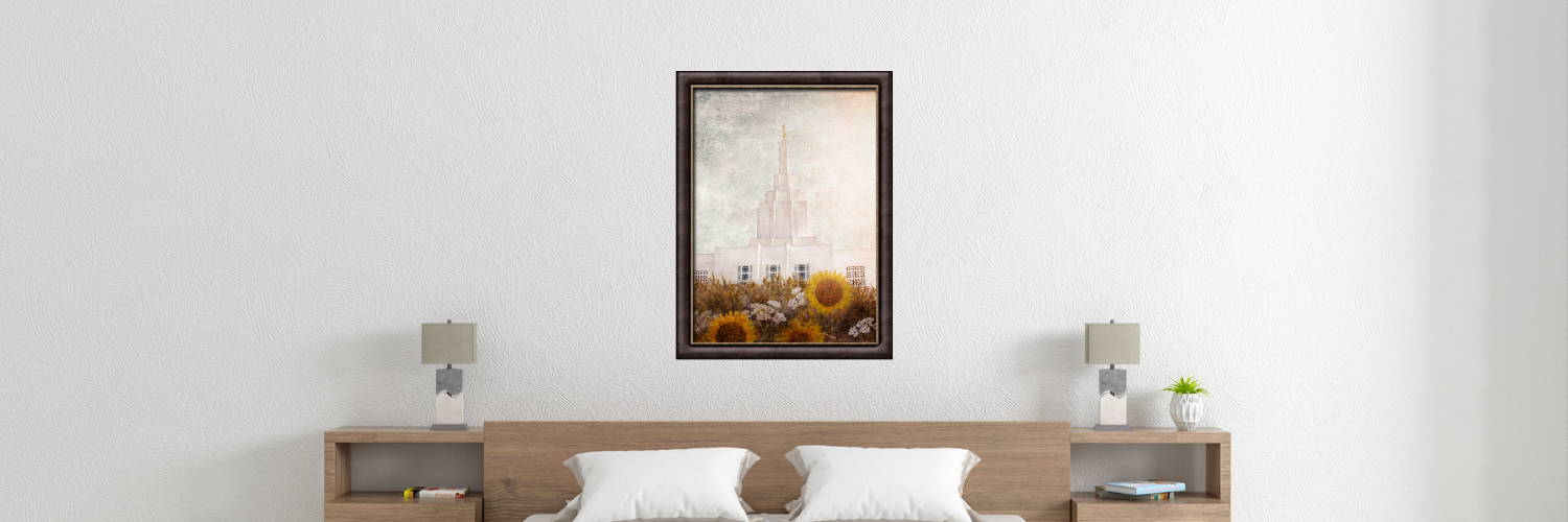 Environment shot of an Idaho Falls Temple painting hanging over a bed.