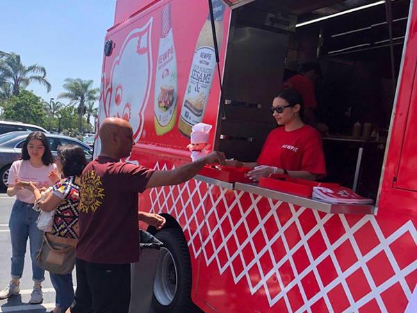 Receiving food order at Kewpie food truck