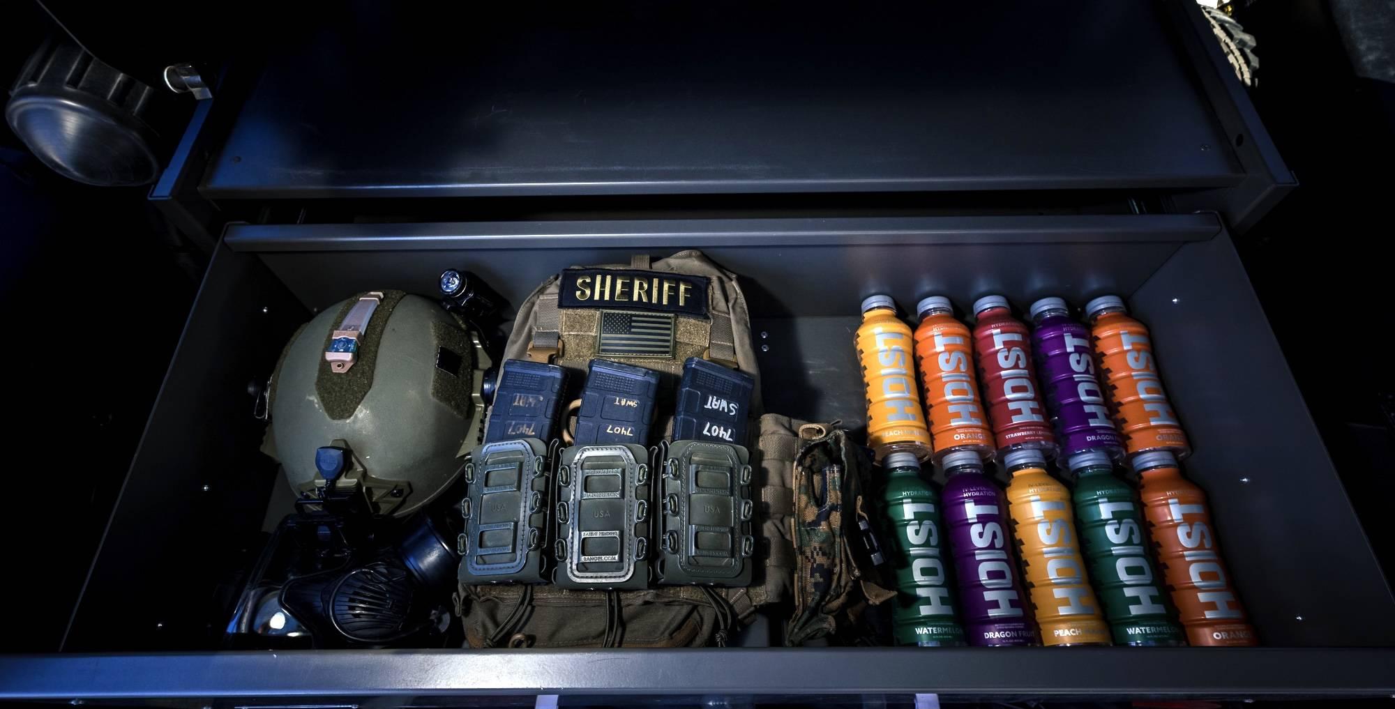 hoist bottles, sheriff badge and case