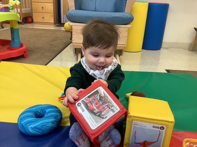 Our Infants are building their minds and fine motor skills with our Balanced learning picture blocks