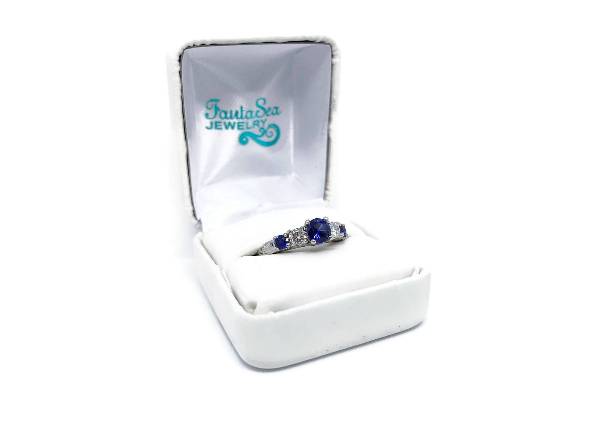 Platinum Engagement Ring with Blue Sapphire