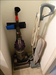 vacuum cleaners Dyson + Oreck