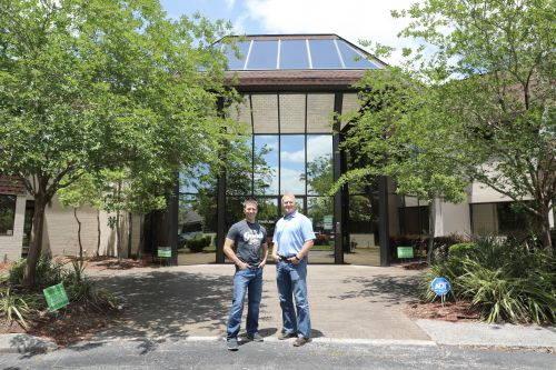 Jason McDonald and Scott Day standing outside of FreshJax Organic Spices Headquarters
