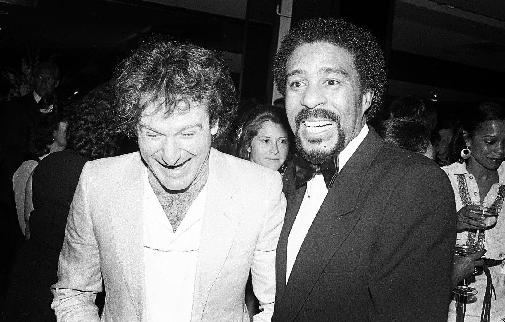 Black and white photograph of Robin Williams and Richard Pryor.