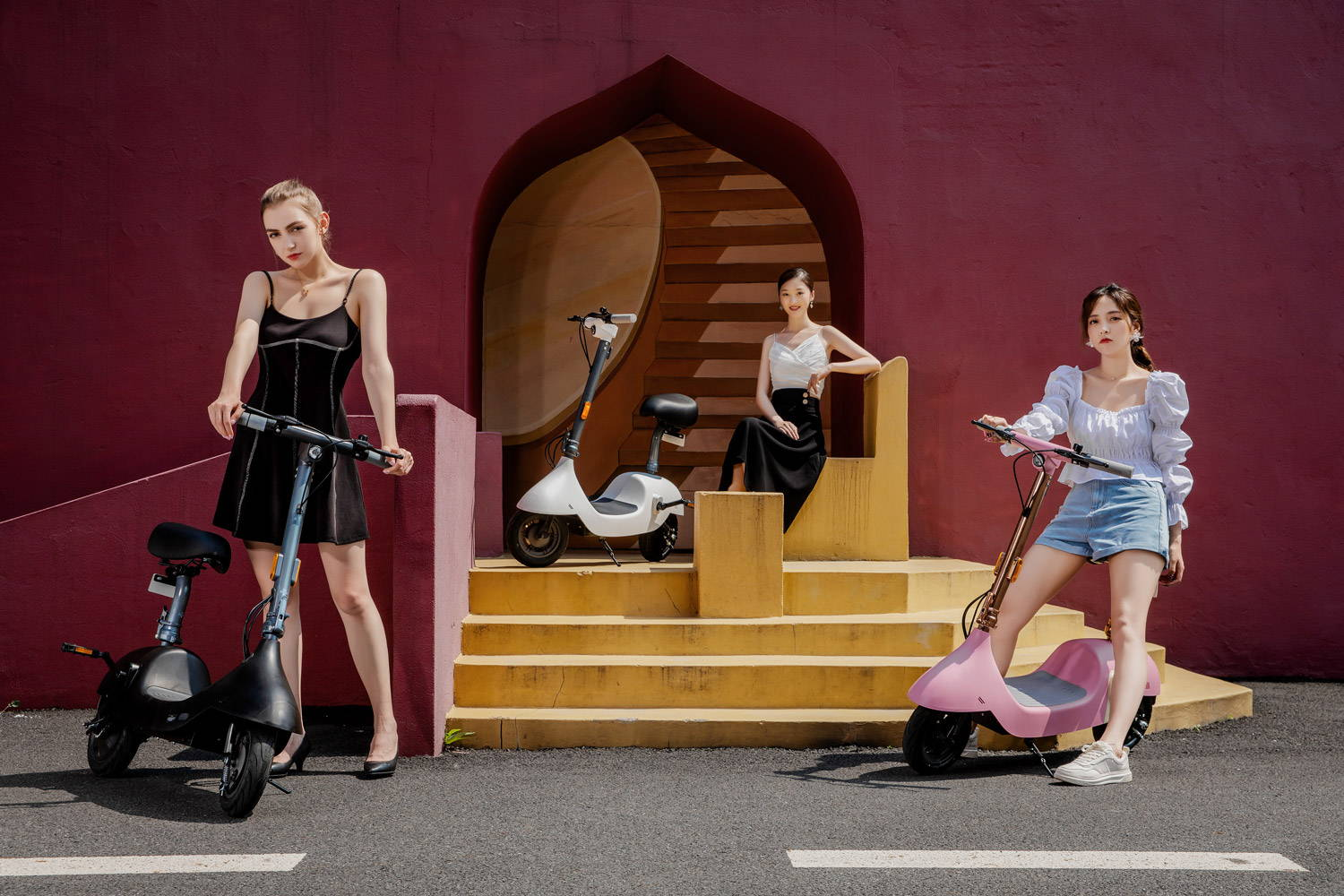 okai ea10 pink black white escooter with seat 3 girls riding together