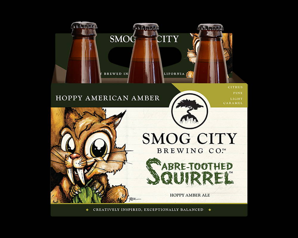 6 pack of Sabre-toothed squirrel bottles with a squirrel with big teeth holding a hop cone. in the top right corner, it reads citrus, pine, light, caramel. text along the bottom reads creatively inspired, exceptionally balanced.