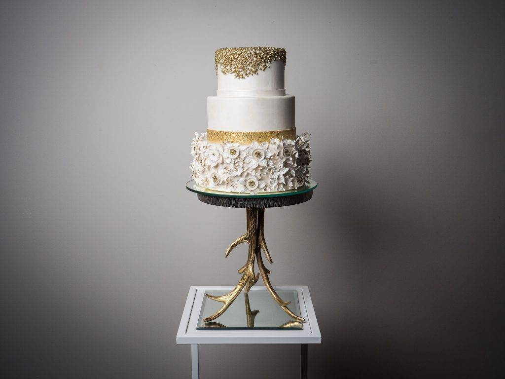 Gold pearls and while floral detailed wedding cake. Available at House of Clarendon. Serving Lancaster, York, Harrisburg, and Philadelphia