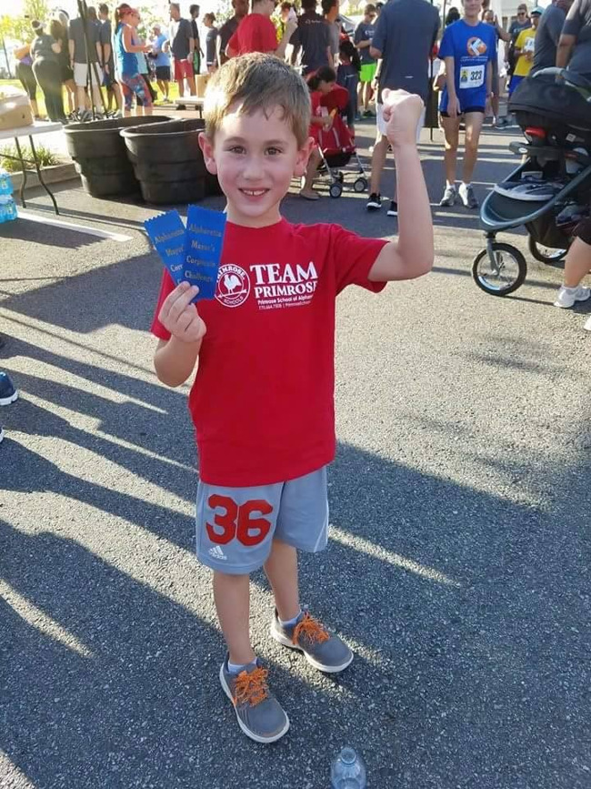 Little boy representing Primrose school at the Alpharetta kid's fun run challenge
