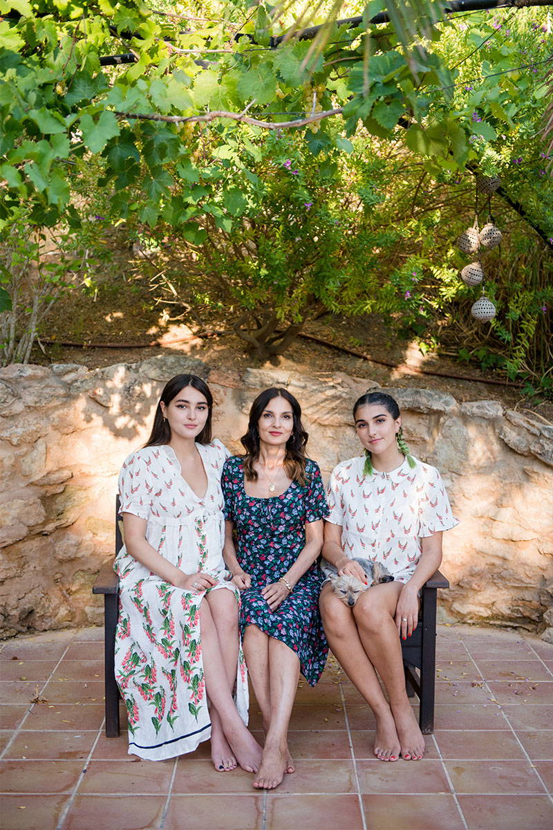 Yasmin Mills and Daughters pose for a picture whilst wearing YOLKE