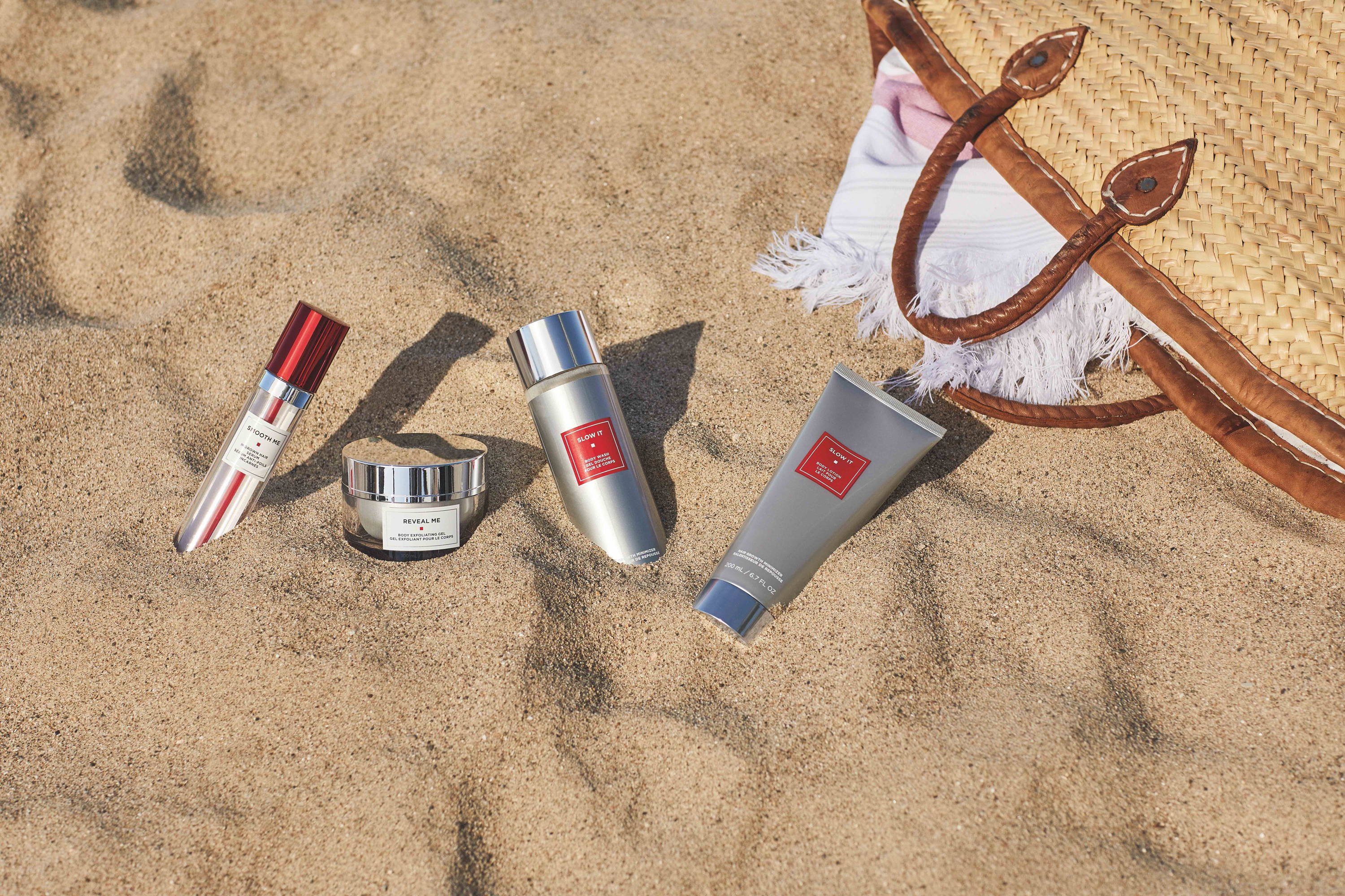 Strut Smoothly® Skincare products for ingrown hairs, exfoliate, and lotion in the sand