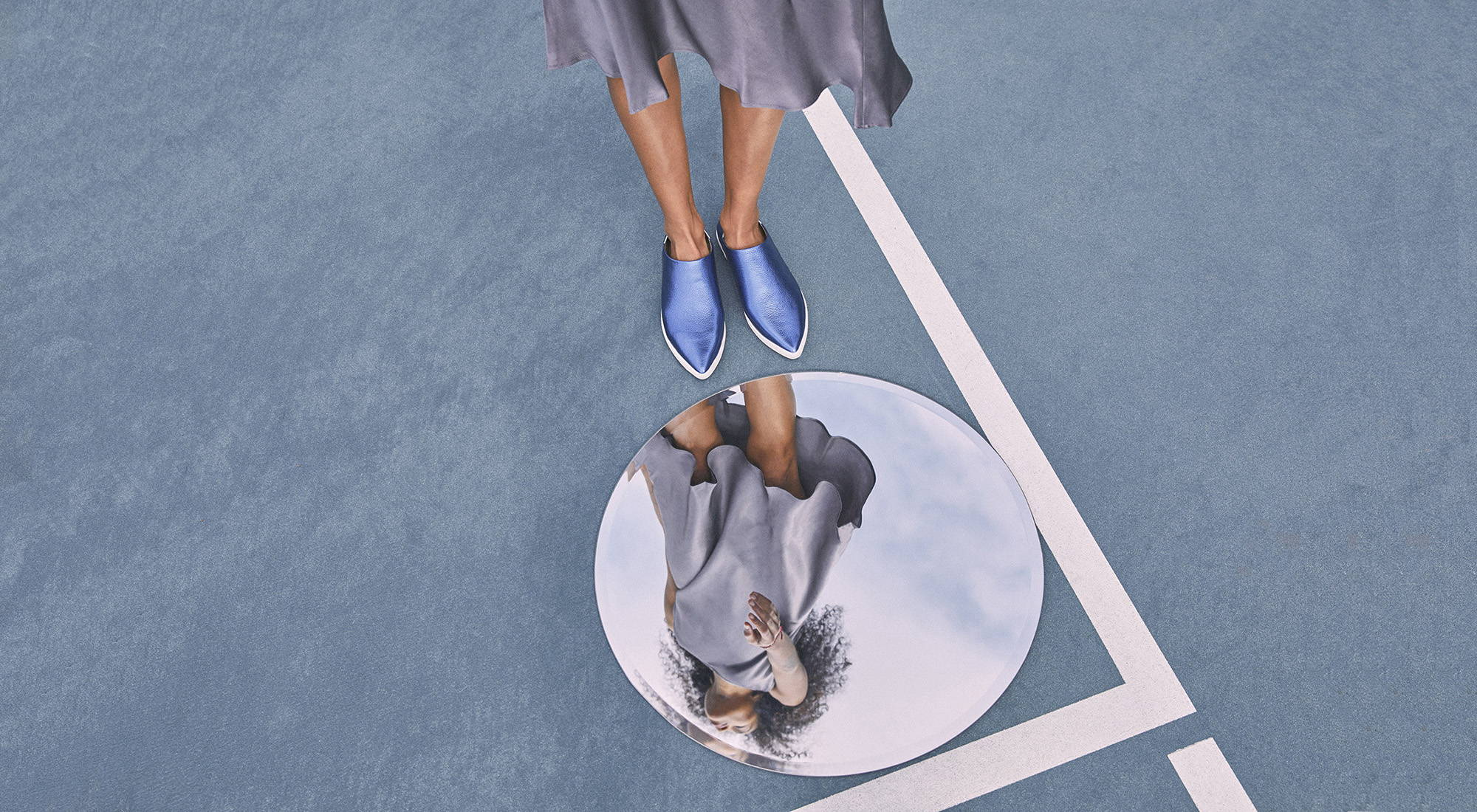 Silver shoes on tennis court