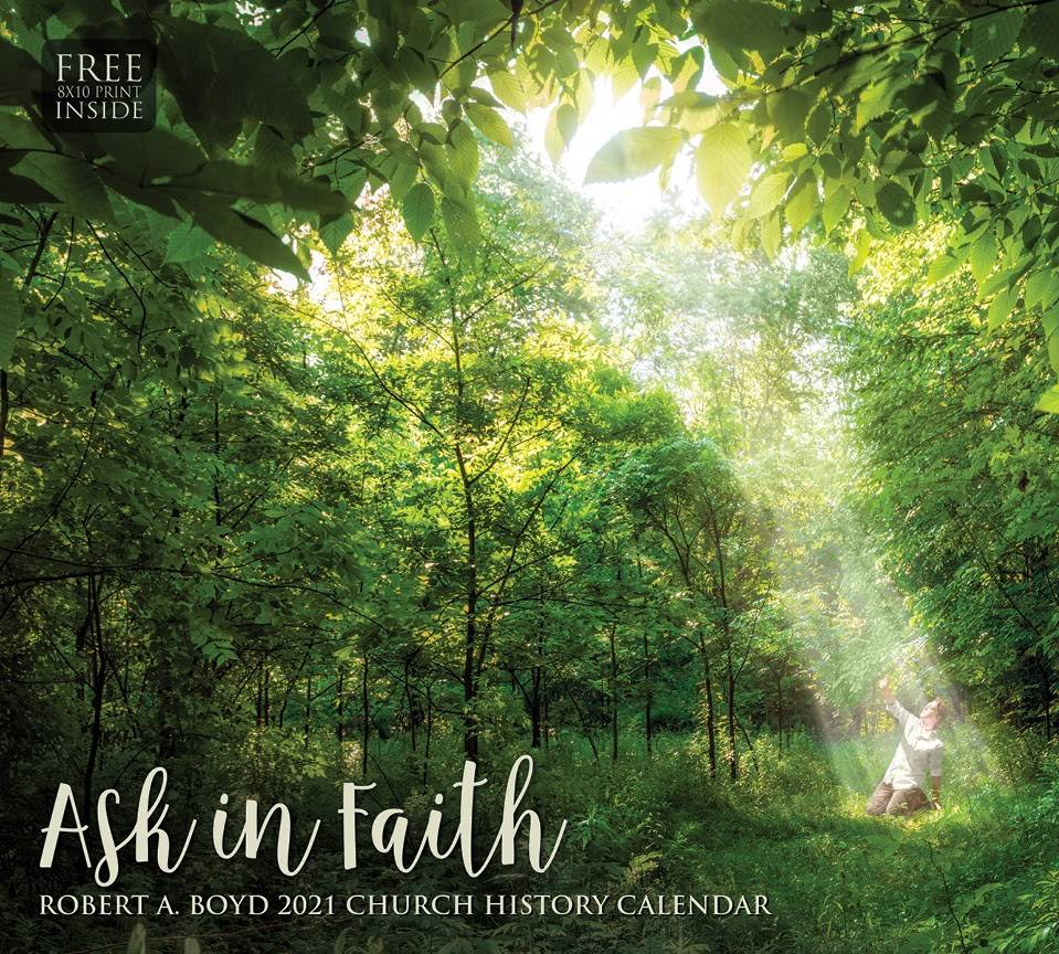Robert A. Boyd's 2021 calendar cover. Light streaming down onto the young Joseph Smith in the Sacred Grove.