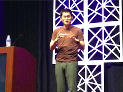 Always innovating: Bo Lu did his part to disrupt fashion by delivering his keynote address in a brown T-shirt and black shoes.