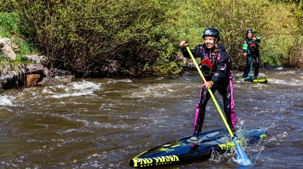 Christian Edie doing the white water sup race on her Pau Hana board